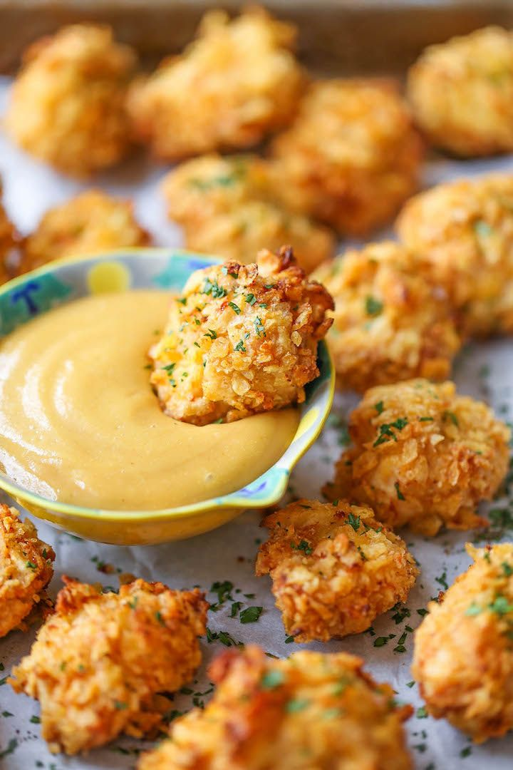 Baked Popcorn Chicken - A healthier alternative to the deep-fried version with the best crispy potato chip crust!! No one will believe that this is baked!