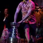 Blackhawks player Patrick Kane dances around the Stanley Cup during a Jimmy Buffett concert at FirstMerit Bank Pavilion at Northerly Island. — Chris Sweda / Chicago Tribune, June 29, 2013