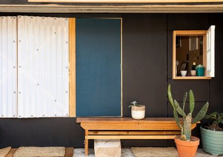 Murray Barker's garage conversion is a nice note on which to wrap up our Backyard Bungalows series. To maximise his compact 18sqm space, he makes great use of the outdoor areas either side of it. Referencing Donovan Hill's D House, Murray has added windows and shutters that encourage interaction with the laneway and the life upon it—while still providing natural light and privacy when required.