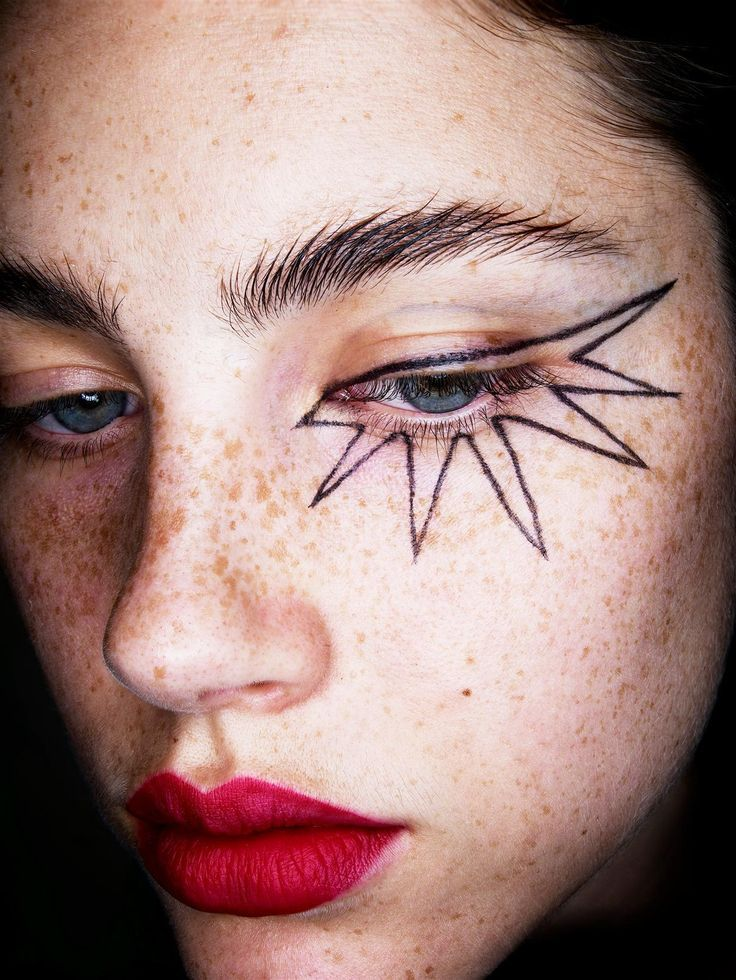 Makeup: graphic liner with a bold lip.
