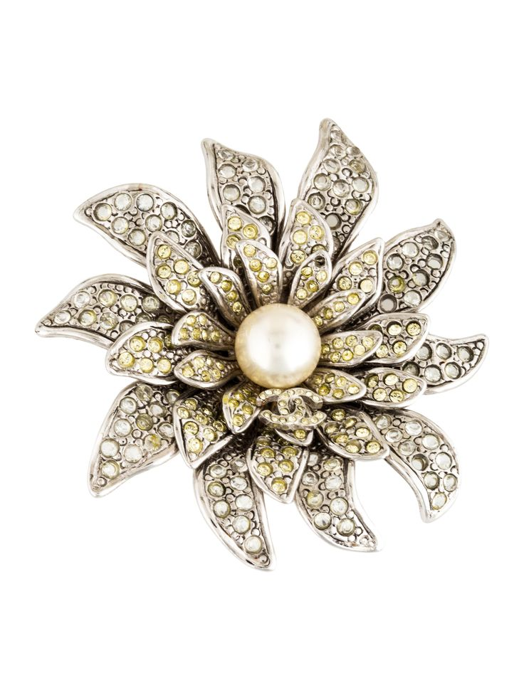Silver-tone Chanel floral brooch featuring crystals throughout, faux pearl at center, CC motif, pin closure at back and additional hook to be worn as a pendant. From the Fall 2005 Collection.