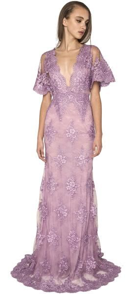 Floral lace lavender gown. The Rena dress is a lavender floral lace embellished dress. This beautiful gown features a detailed low V neckling, short flared embellished sleeves and a detailed hemline. It is designed as a slim fit and gradually flares at the mid thigh. This dress gives off a beautiful soft feel. #evening #floral #lace #bigsleeves #violet #vneck #NARCES