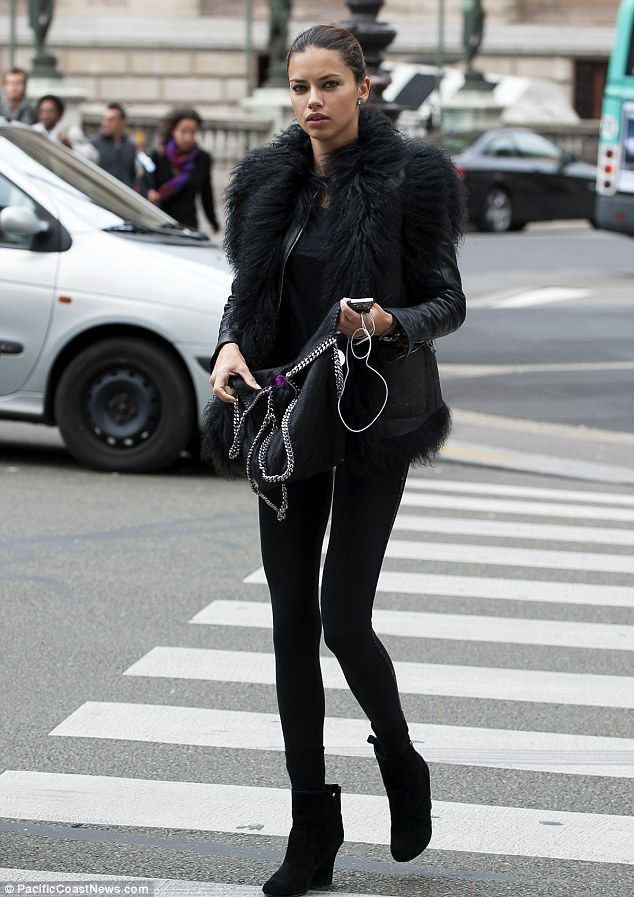 Adriana Lima looked chic as she walked around the French capital ahead of Paris Fashion Week