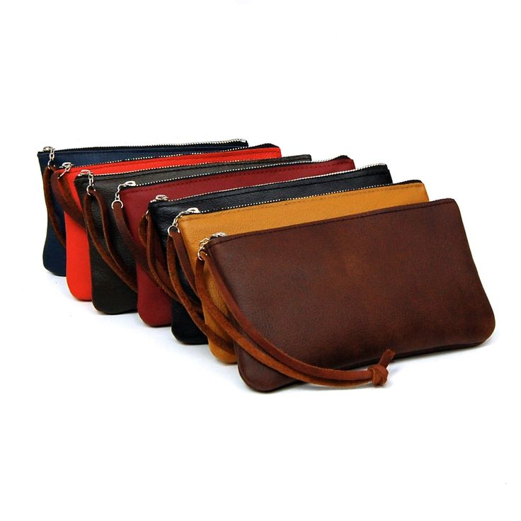 Colorful leather clutch bags by Stitch & Rivet. Fits phone, keys and even a Mini Wallet. Handmade, with a nickel zipper and a brown leather wrist strap. Choose from seven colors.