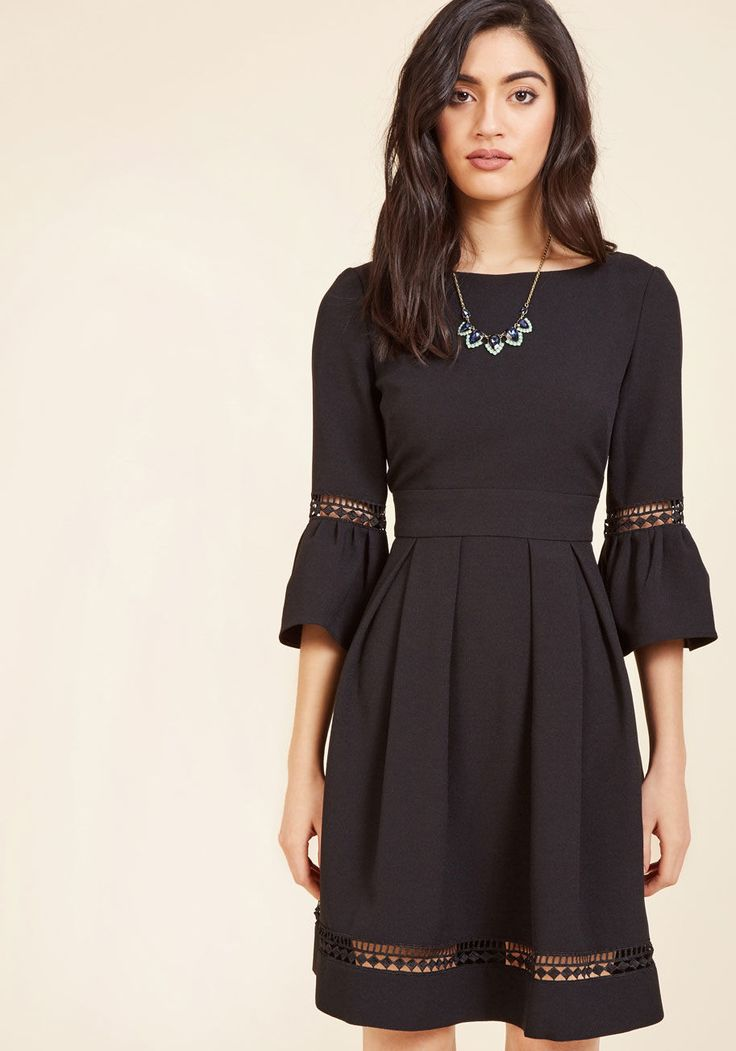 <p>With this black dress from Eliza J, you don't just outfit yourself in an elegant look - you also celebrate your most natural attributes! Highlighting your signature sophistication with its cropped bell sleeves, sheer geometric trimmings, and hidden pockets, this crepe LBD is an instinctive wardrobe addition.</p>