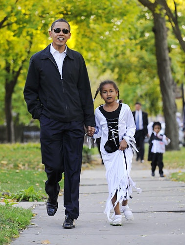 President Barack Obama with daughter, trick or treating.