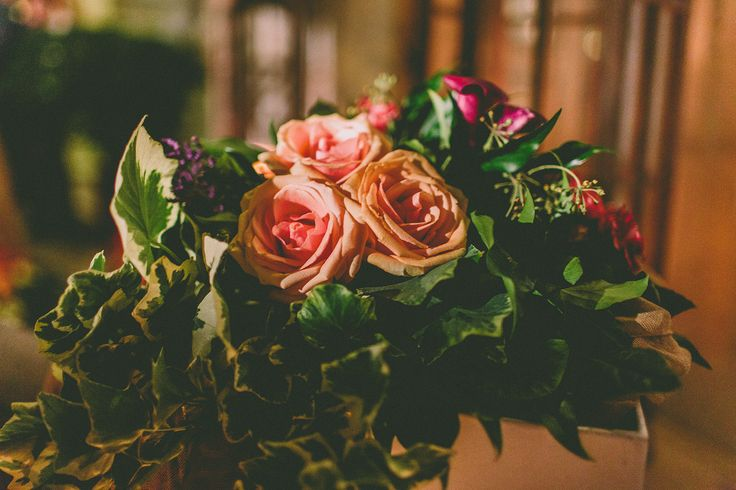 Green , burgundy, purple and pink all in a flower bouquet.