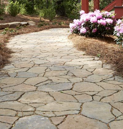 Garden Path ~ Interlocking pavers, sculpted to resemble natural flagstone, blend effortlessly into the natural environment.