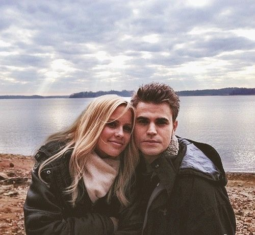Claire Holt and Paul Wesley behind the scenes of The Vampire Diaries.