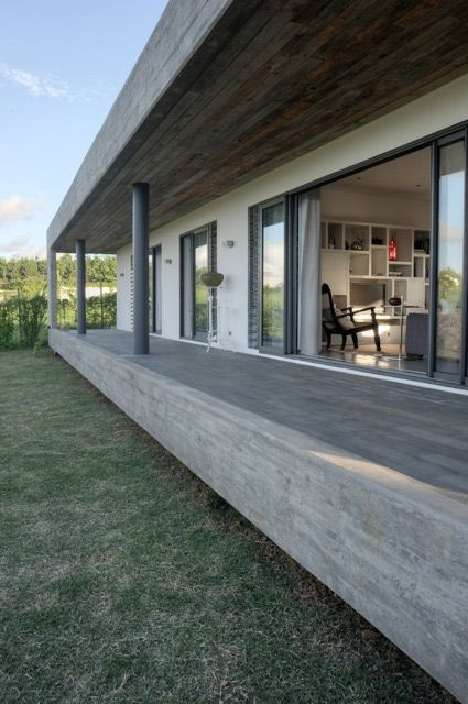 Architecture firm Rethink Studio designed this simple, rectangular concrete house with a deliberate rustic edge and a cool countryside aesthetic. This horizontal house involved a special design request by the...