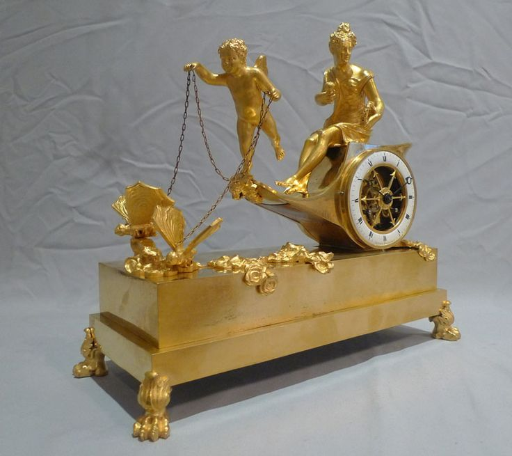 Antique French Empire chariot clock in ormolu signed Ravrio.
