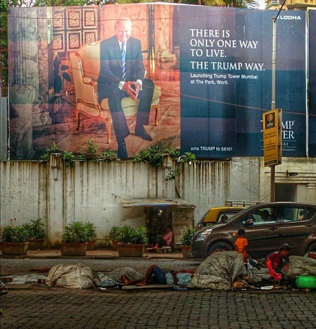 """In this photo from what seems like a real-life scene out of """"The Great Gatsby,"""" a bizarre re-imagination of Dr. T.J. Eckleburg looks down on the valley of ashes. This Photo Of A Trump Billboard In Mumbai Is Real, And So Is The Dark Irony 