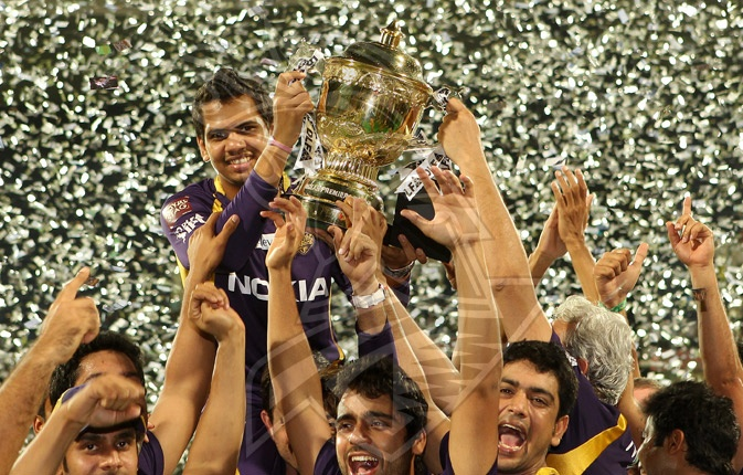 Player of the tournament Sunil Narine is lifted up in the air by his team mates