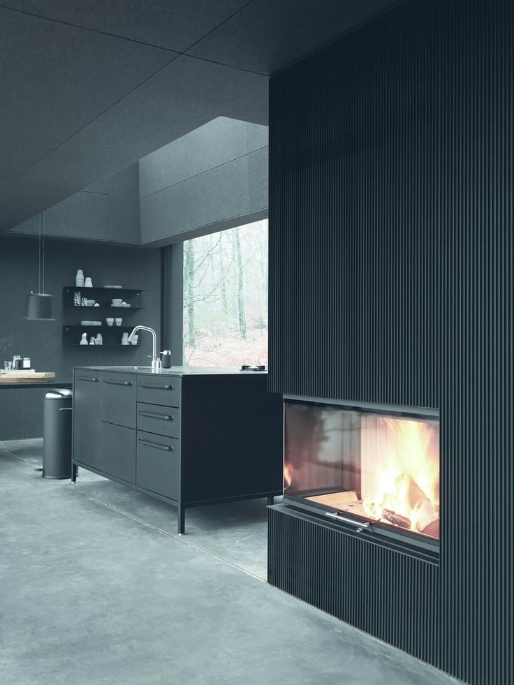 An Experimental New Hotel Includes a Steel Prefab and a Copenhagen Loft - Photo 4 of 9 - A Vipp kitchen and fireplace offer an upscale dining experience, even in the wilderness.