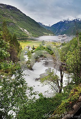 The river in Geirangerfjord Cruise Port with a cruise ship.