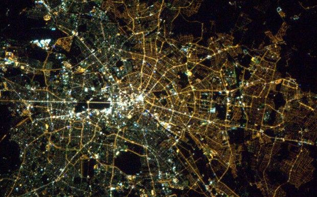 East vs West Berlin today:  This image from space highlights the higher levels of commercial activity in the west, over two decades after the fall of the Wall.