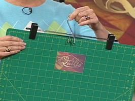 Store cutting mats using clothes hanger and a hook on the wall.