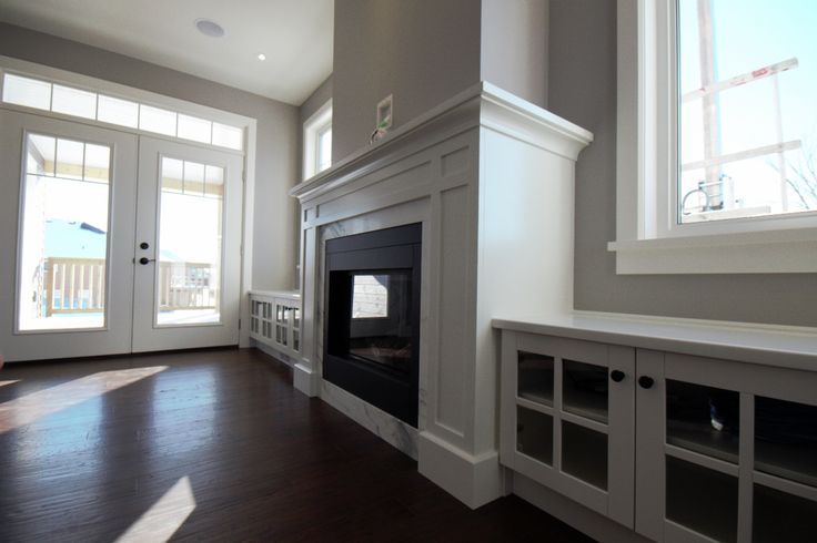 Gas fireplace with marble surround and white painted mantle