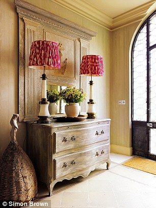 In the hallway, Kit has teamed a limed chest of drawers by Julian Chichester (julianchichester.com) with an antique Swedish mirror. Unusual lamp bases found on her travels are paired with ikat lampshades; Melodi Horne sells similar shades (melodihorne.com)