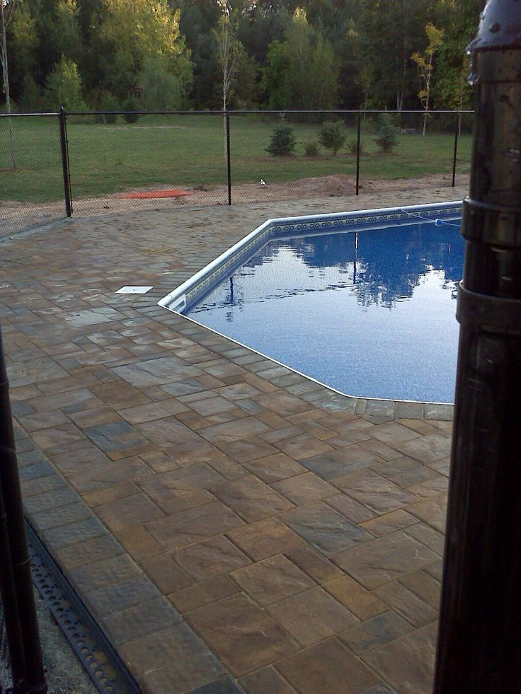 Cambridge pavers around a new pool install walkways - Installing pavers around swimming pool ...
