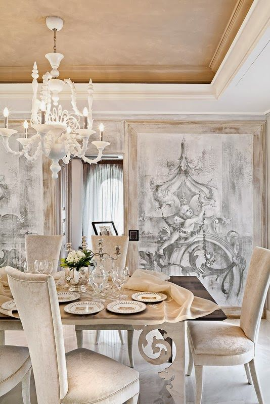 Hand painted door panels close to give this dining room privacy and gorgeous muted art.