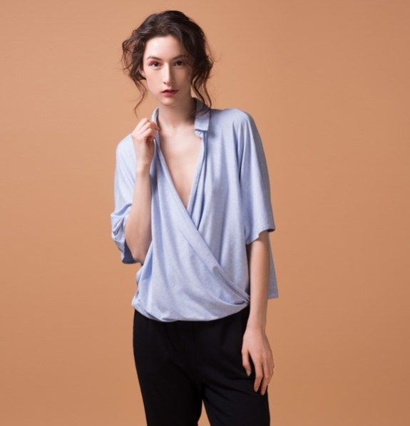Odeyalo-renard-blouse-2  Who says blouses has to be structured and uncomfortable?  Of course not us!  This cute blouse has everything it needs to become your favorite shirt.  Made in a super soft bamboo blend jersey that drapes perfectly.  It has a little button at the collar so you can wear it proper way or wide open as a V shirt.    Model is 5'8″/173 cm and is wearing size XS  66% bamboo rayon/ 28% cotton/ 6% spandex  Designed and made in Montreal.