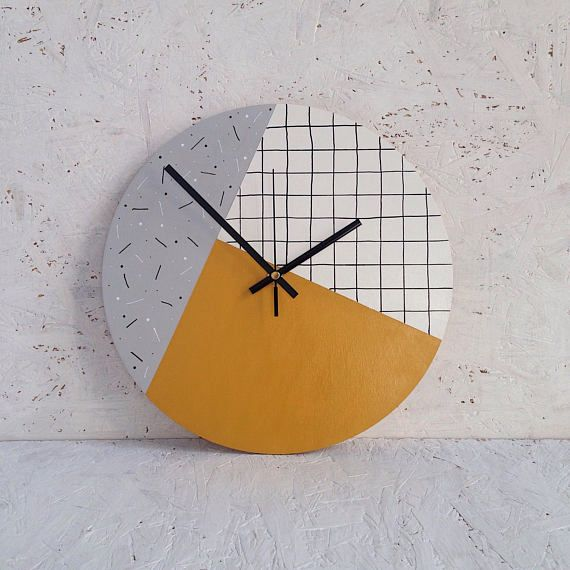 This is Amber, a mustard yellow wall clock with accents of light grey and white. A unique wooden clock that has been carefully painted and varnished by hand. The perfect accompaniment for a minimalist lifestyle, this piece of home decor will add a subtle splash of colour to your