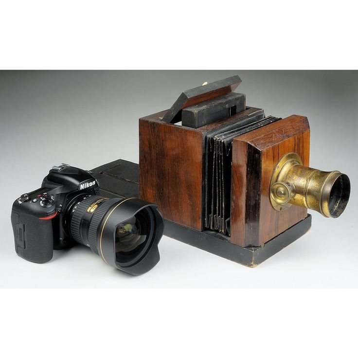 160+ Years of Camera Evolution - photographic state-of-the art then and now: The rosewood veneered beauty next to the latest Nikon DSLR is an 1853-54 Palmer & Longking daguerreotype camera. Silver coated polished copper plates back then and electrons now. Both are considered state-of-the-art for their time. But what a difference in user experience and results!
