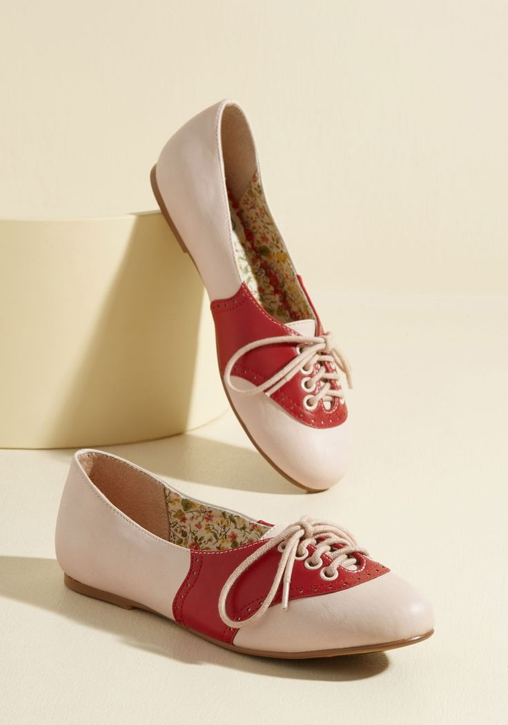 Study Buddies Flat in Red | Mod Retro Vintage Flats | ModCloth.com  Lace up these Oxford-inspired flats by Bettie Page for your date with the library! Constructed partially from faux leather and flaunting delicate perforations atop a red-and-cream color scheme, these ModCloth-exclusive kicks are the cutest possible pair to help you with an afternoon of research.