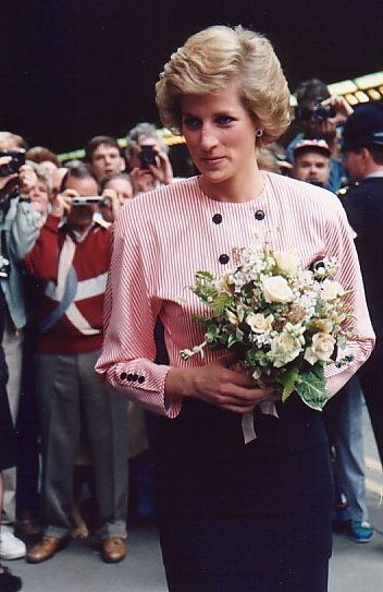Princess Diana Is Given A Bouquet Of Flowers At Every Function She Attends.