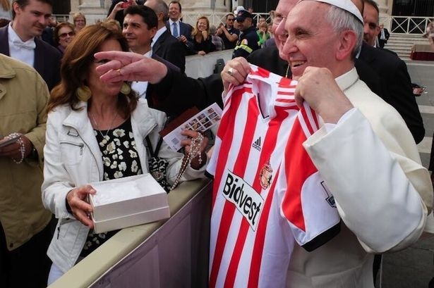 Pope Francis receives a Sunderland shirt