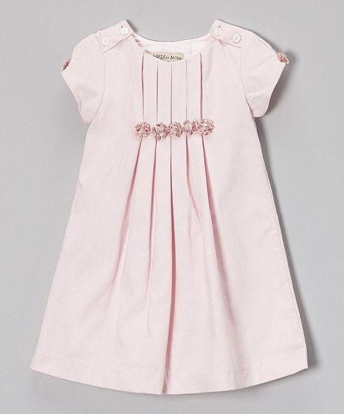 Made precious to delight little loves, this corduroy dress boasts pretty pleats and contrasting blossom accents. Crafted from comfy cotton and finished buttons up top, it'll charm darlings with each and every wear. 100% cottonMachine wash; tumble dryImported