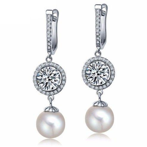 cercei mireasa cu perle si cristale http://www.bijuteriifrumoase.ro/cumpara/cercei-lungi-mireasa-cu-cristale-si-perle-3310