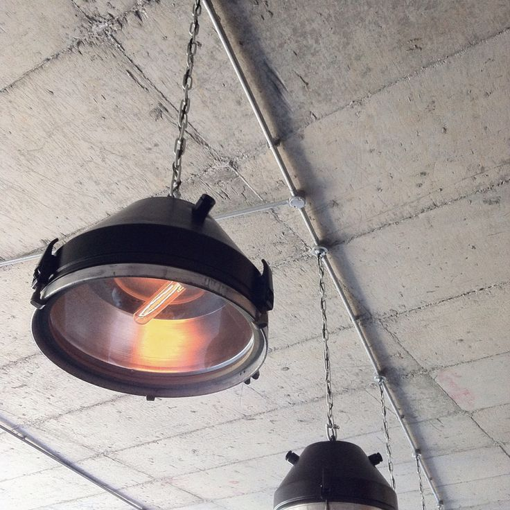 Our ceiling lamps where converted from old ship window holes #design #decor