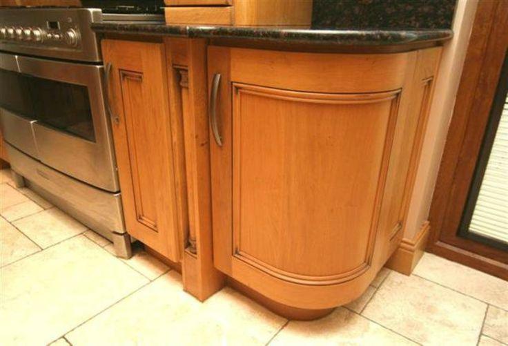 traditional oak curved door cabinet www.pauljameskitchens.com