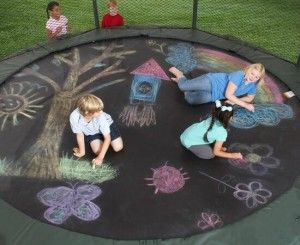 Turn your trampoline into a big painting with chalks. Love this idea for when you're tired of bouncing. And it just rubs off in the rain!