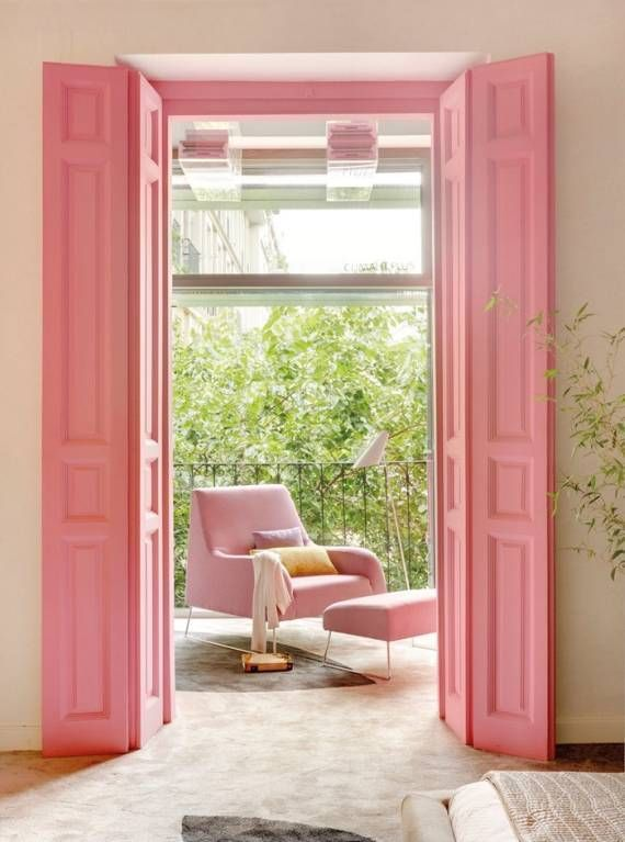 Every little girl's dream is made true by these tall pink doors, which complement a pink chair nicely while playing off off the natural greenery that surrounds the space.