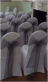 white spandex chair cover hire london, silver organza wedding chair bow sashes hire london, silver sashes hire london essex