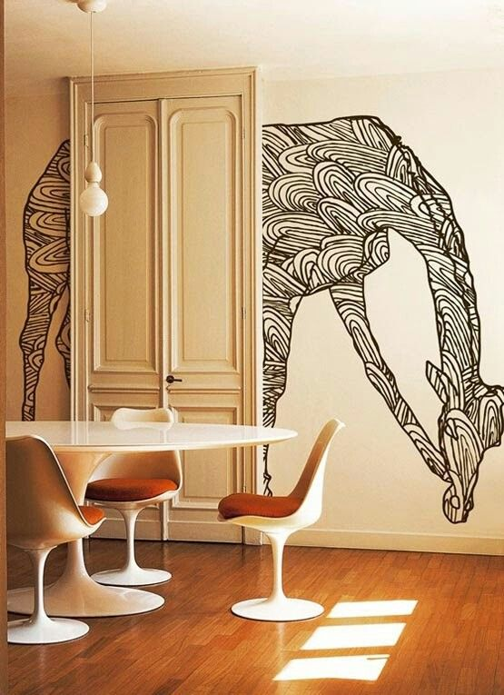 Wall mural treatment would be so fun in a kids room! Love the atypical placement through the door.