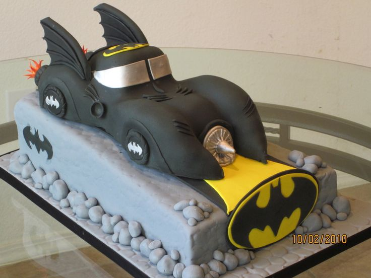 Batmobile cake made using vanilla cake and vanilla buttercream. Batmobile is all cake and was hand carved, covered in fondant and was totally edible.