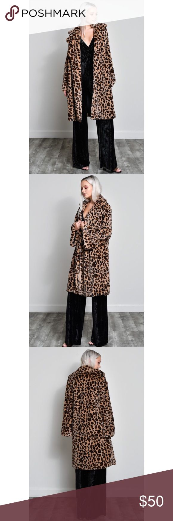 Knee length leopard coat Very cozy and warm coat. On trend leopard print. Knee length for most people depending on height. Oversized trench style. Most likely not waterproof, extremely soft faux fur material. Jackets & Coats Trench Coats