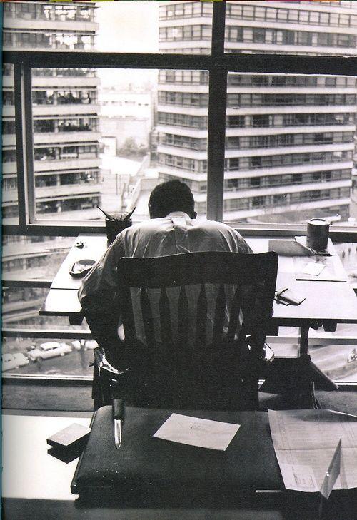 """Abel Quezada trabajando en su restirador en su despacho de la calle Morelos, ca.1962. Foto: Héctor García. La foto la pueden encontrar en el libro """"Códice AQ. Abel Quezada"""". — en Museo del Noreste."""