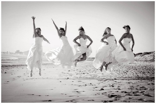 SO PERFECT!! After the last friend gets married, everyone puts on their wedding gowns one last time for a photo shoot.