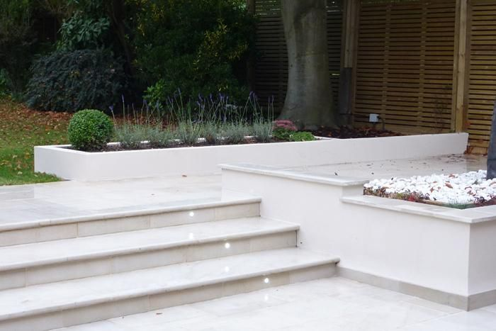 Bullnose Step treads to match in with contemporary beige sawn sandstone paving.  This garden was designed by Gardenplan Design and built by Avalon Landscapes of the West Midlands