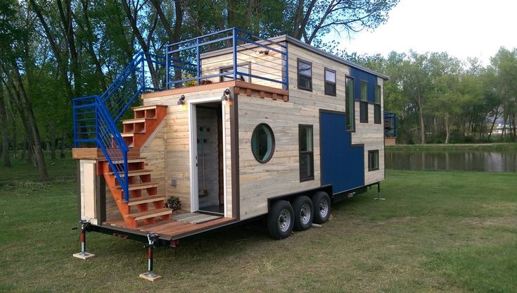 The Tiny Ski Lodge is based on a 30 ft (9.1 m)-long triple axle trailer