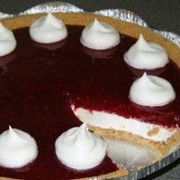 No-Bake Raspberry Cream Pie Recipe Submitted By: Diane Pittman Vasseur Wow your holiday guests with this festive layered pie! Graham cracker crust, no-bake cheesecake filling, and a homemade raspberry topping. 1 (2-extra servings size) pre-made graham cracker crust Cream Cheese Layer: 4 ounces (half of 8 oz block) cream cheese, slightly softened 1/4 cup sugar…