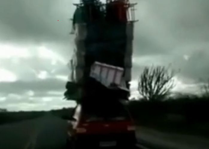 This is a real life funny video of an overloaded car. You need a pick-up truck if your car looks like this.