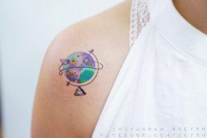 Travel-themed globe tattoo by Sey8n