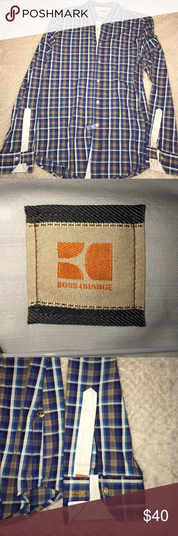 HUGO BOSS Orange Dress shirt button down sz M 100% Authentic BOSS Orange dress shirt Plaid pattern. Beautiful button down under a suit or alone. Can be worn during all seasons. Size M fits true to size. Have over 50 more Hugo Boss shirts to come. Stay tuned! ALL DRESS SHIRTS DRY CLEANED BEFORE SHIPMENT. Hugo Boss Shirts