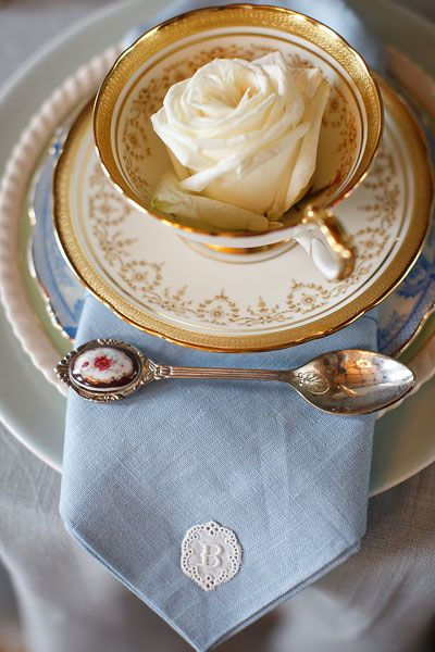 Tea Party Place Setting | a single rose bloom in each tea cup